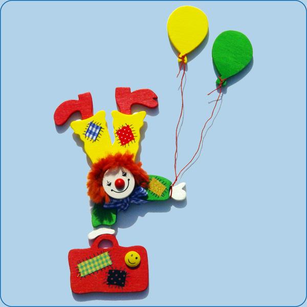 Clown mit Luftballon und Koffer